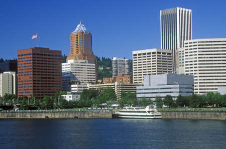 willamette: Skyline of Portland from the Willamette River, OR in morning Editorial