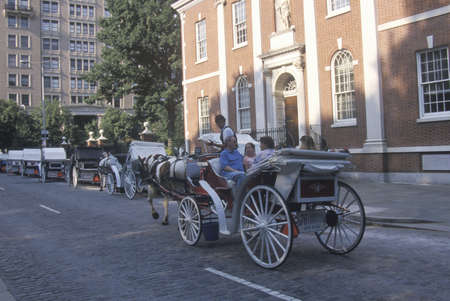 historic district: Horse and carriage riding in historic district of old Philadelphia, PA, in front of Independence Hall, home of Declaration of Independence and US Constitution