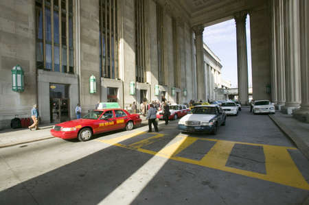brotherly love: Exterior view of red taxi cab in front of the  30th Street Station, a national Register of Historic Places, AMTRAK Train Station in Philadelphia, PA