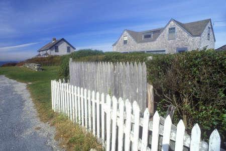 ri: White picket fence along Route 77 in Sakonnet, RI