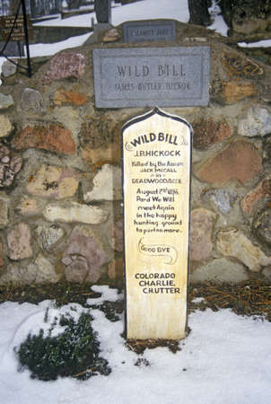 grave site: Grave site of Wild Bill Hickock, infamous outlaw in Mount Moriah Cemetery, Deadwood, SD in winter snow