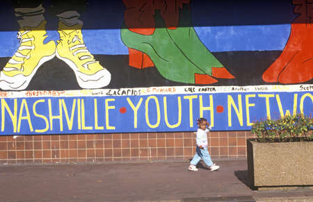 tn: Nashville Youth Network mural with young African American girl in foreground Editorial