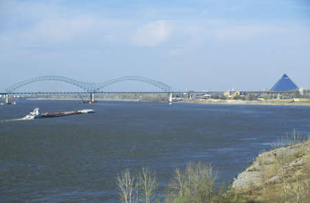 tn: Barge on Mississippi River with Bridge and Memphis, TN in background
