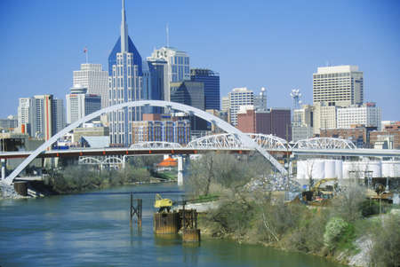 tn: State capitol Nashville, TN skyline with Cumberland River in foreground