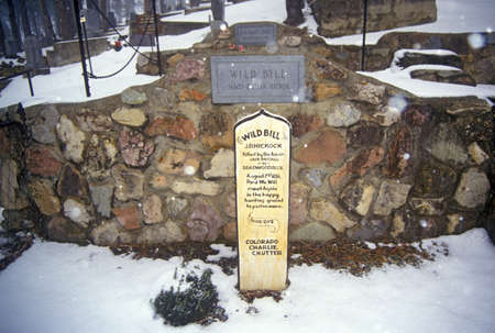 infamous: Grave site of Wild Bill Hickock, infamous outlaw in Mount Moriah Cemetery, Deadwood, SD in winter snow