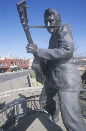 tn: Statue of a young Elvis Presley on Beale Street, Memphis, TN Editorial