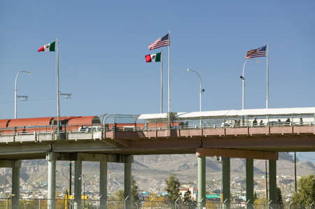 bridges: International border of Mexico & the United States, with flags and walking bridge connecting El Paso Texas to Juarez, Mexico Editorial