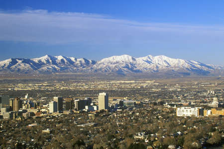 wasatch: Skyline of Salt Lake City, UT with Snow capped Wasatch Mountains in background