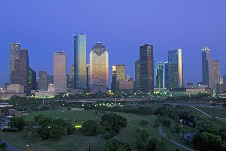 Houston, TX skyline with Memorial Park in foreground at dusk