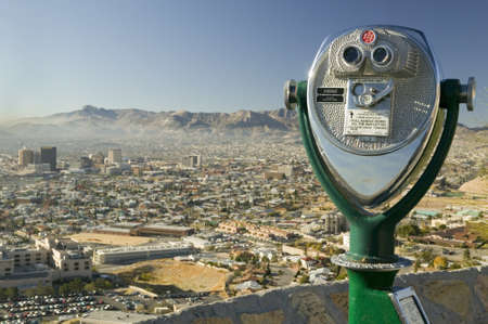 Long range binoculars for tourists and panoramic view of skyline and downtown of El Paso Texas looking toward Juarez, Mexico