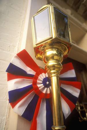 va: Front door with patriotic decorations on building in Alexandria, VA