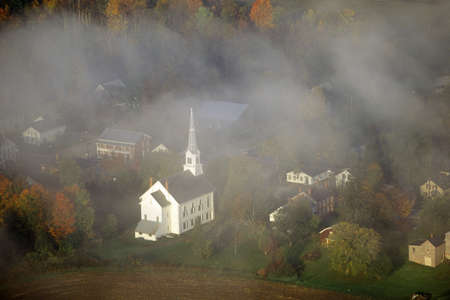 Aerial view of Stowe, VT in Autumn on Scenic Route 100, through fog
