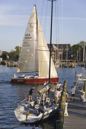 Golden sails of weekly sailboat race at Yacht Club in Annapolis, Maryland Stock Photo - 20512024