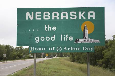 good life: Welcoming sign to Nebraska...The good life, Nebraska state line Editorial