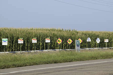 Advertisements lining cornfield, like old Burma ads, along Nebraska highway