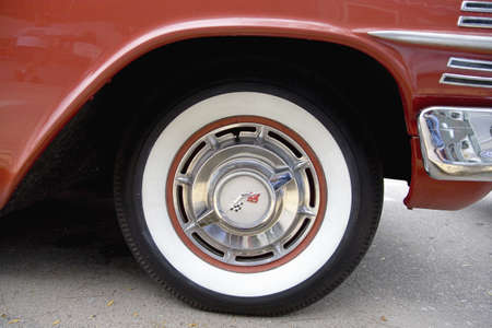 Detail of white-wall tire on 1960 restored red Chevy Impala, Grand Island, Nebraska