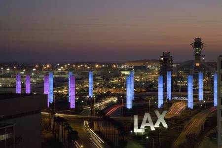 airport sign: Aerial view of LAX Los Angeles International Airport at sunset with decorative light tubes, Los Angeles, California