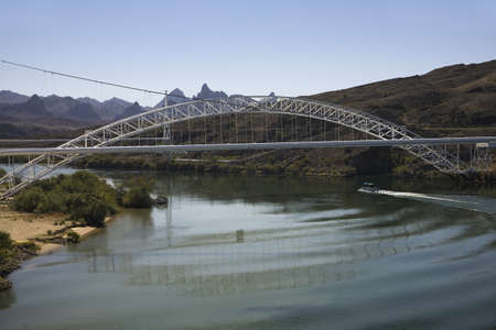 Bridge crossing Colorado River with turquoise color water from Needles California into Arizona Stock Photo - 20491775