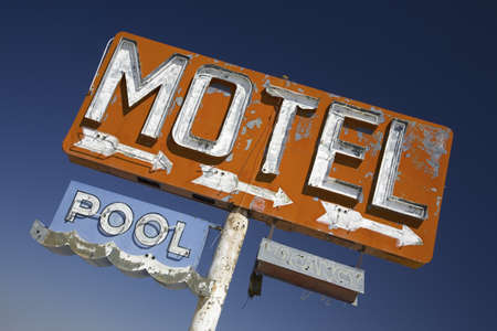 old sign: Old 1950s neon sign reading Motel Pool in remote part of desert of Arizona