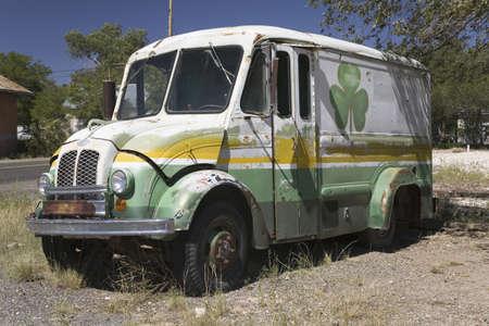 rusting: Vintage rusting milk truck parked off Route 66 in Seligman, Arizona Editorial