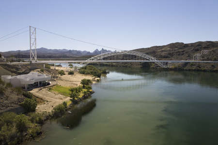 Bridge crossing Colorado River with turquoise color water from Needles California into Arizona Stock Photo - 20491814