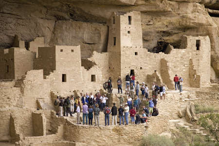 kiva: Tourists viewing kiva at Cliff Palace cliff dwelling Indian ruin, the largest in North America, Mesa Verde National Park, Southwestern Colorado