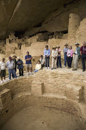 the dwelling: Tourists viewing kiva at Cliff Palace cliff dwelling Indian ruin, the largest in North America, Mesa Verde National Park, Southwestern Colorado