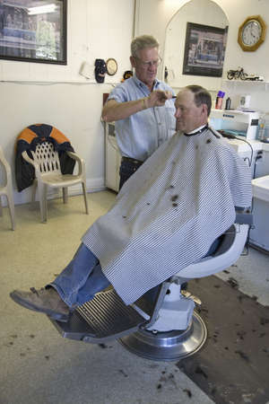 haircut: Man getting haircut in Gordons Barbershop in Palisade Colorado, east of Grand Junction Editorial