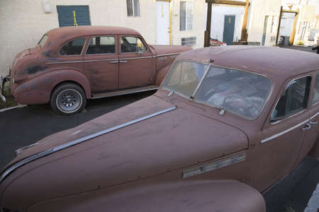 barstow: Vintage rusty 1940s car parked in front of Route 66 Motel, Barstow California