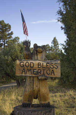 stating: A wooden bear and US Flag stating God Bless America, Colorado