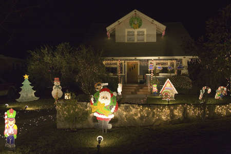 christmas house: Santa Claus waving in front of house with Christmas lights in Oxnard, California