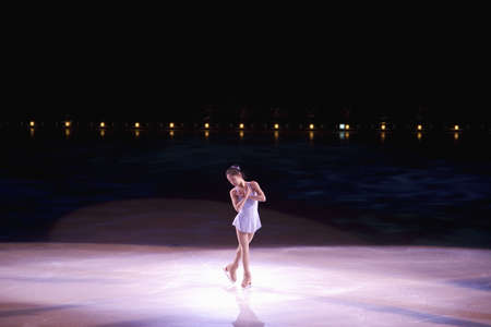 professional ice skater performing from champions on ice may
