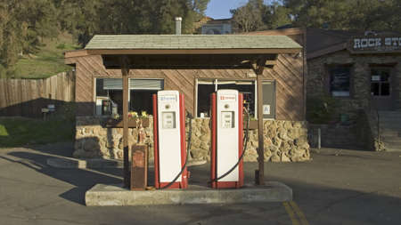 Antique red gas pumps in front of old gas station in Malibu, Southern California north of Los Angeles