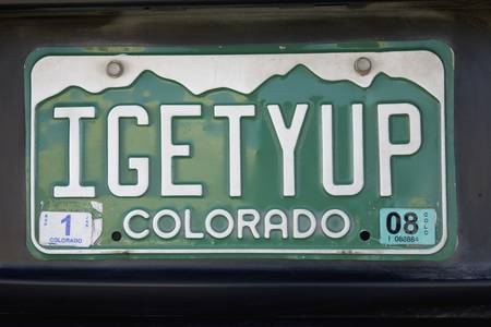 license plate: Colorado license plate spelling Igetyup, giddy-up