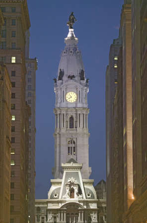 brotherly love: William Penn statue on the top of City Hall at dusk from Broad Street, Philadelphia, Pennsylvania, the City of Brotherly Love