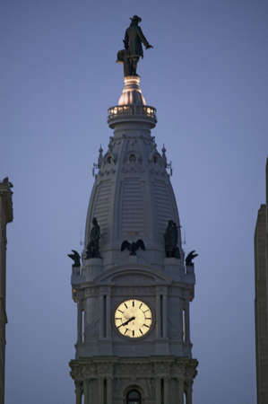 brotherly love: William Penn statue and clock on the top of City Hall at dusk from Broad Street, Philadelphia, Pennsylvania, the City of Brotherly Love