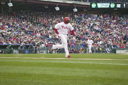 brotherly love: Major League baseball player for the Philadelphia Phillies, #6, slugger Ryan Howard, running to first base during March 31, 2008 opening game against Washington Nationals, at Citizens Bank Park where 44,553 watch the Nationals defeat the Phillies 11 to 6.