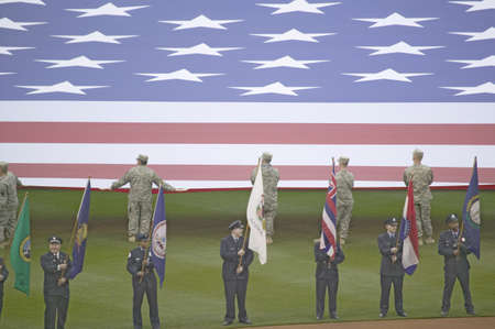 brotherly love: Opening Day Ceremonies featuring gigantic American Flag on March 31, 2008, Citizen Bank Park where 44,553 attend as the Washington Nationals defeat the Philadelphia Phillies 11 to 6. Editorial