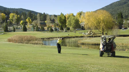 golf of california: Golfer playing 9-hole golf course in autumn at Pine Mountain Club, California Editorial