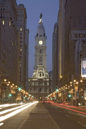 brotherly love: William Penn statue on the top of City Hall at dusk and streaked car lights from Broad Street, Philadelphia, Pennsylvania, the City of Brotherly Love Editorial