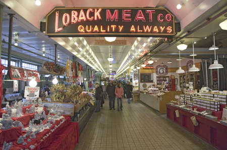 Pike Place Fish Market, in downtown Seattle, Washington, displaying Loback Meat Co. neon sign in interior view of the fish market