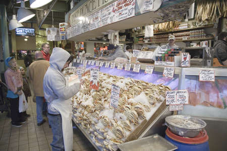 Pike Place Fish Market, in downtown Seattle, Washington displaying fresh fish for sale in interior view of the fish market