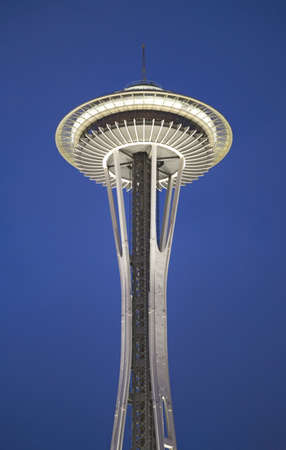 Space Needle in Seattle, Washington at dusk in deep blue sky; it is a major landmark and a symbol of Seattle. Located at the Seattle Center, it was built for the 1962 Worlds Fair