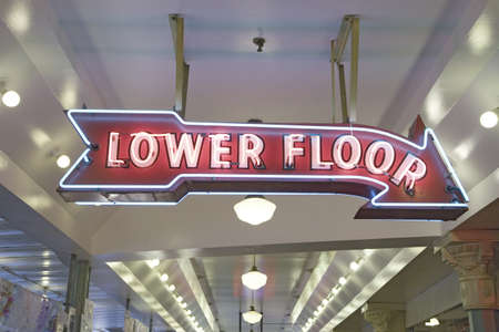 pike place market sign: Pike Place Fish Market, in downtown Seattle, Washington displaying Lower Flow neon sign in interior view of the fish market Editorial