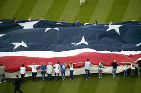 Unfurling of gigantic American Flag during opening ceremony of National League Championship Series (NLCS), Dodger Stadium, Los Angeles, CA on October 12, 2008 Stock Photo - 20512252
