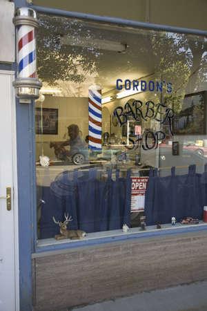 barbershop: Man getting haircut in Gordons Barbershop in Palisade Colorado, east of Grand Junction Editorial