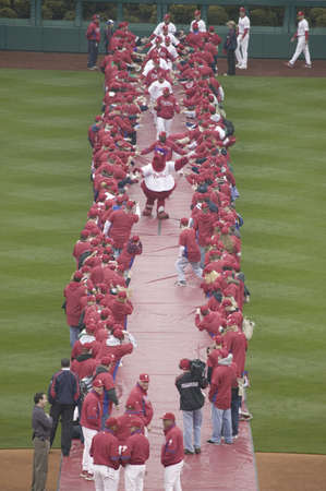 introductions: Red carpet being rolled out for player introductions of the 2008 Opening Game of the Philadelphia Phillies on March 31, 2008, Citizen Bank Park where 44,553 attend as the Washington Nationals defeat the Philadelphia Phillies 11 to 6.