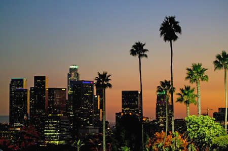 Palm trees at sunset rise above Los Angeles skyline as seen from Dodger Stadium during NLCS baseball series, October 12, 2008