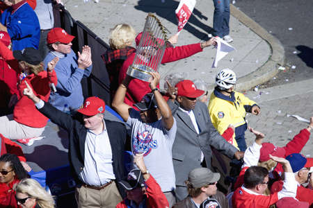 outfield: Bus with Philadelphia Phillies and Mayor Michael Nutter hoisting World Series trophy over his head, next to Phillies manager Charlie Manuel, Phillies World Series victory October 31, 2008 with parade down Broad Street Philadelphia, PA Editorial