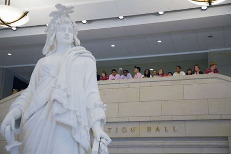 Students visiting U.S. Capitol look down on statue of Statue of Freedom at the U.S. Capitol Visitors Center, Washington, D.C.